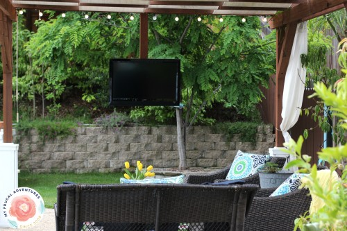 how to add a tv to a pergola outside