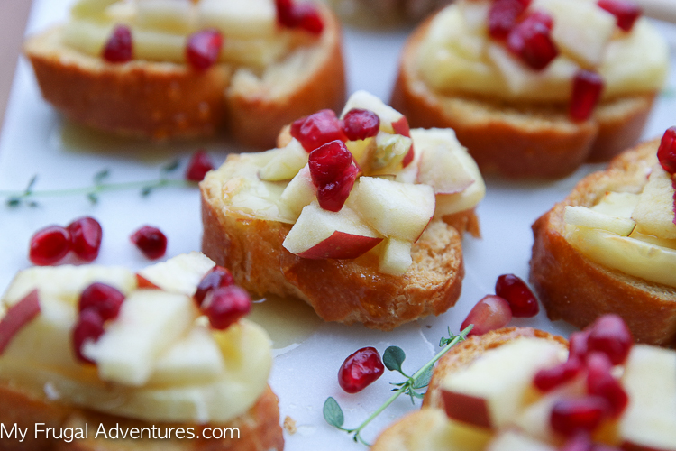 Brie Crostini recipe on myfrugaladventures.com. Brie, Honey and Pomegranate crostini recipe that is a perfect appetizer for any party.