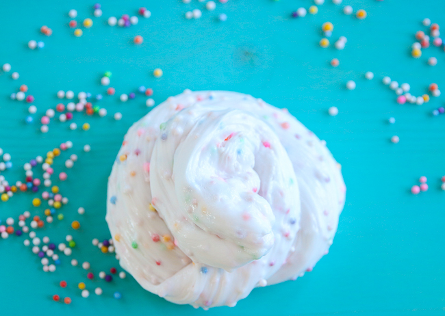 Funfetti or birthday cake slime recipe on myfrugaladventures.com.  Image of foam beads in a rainbow slime.